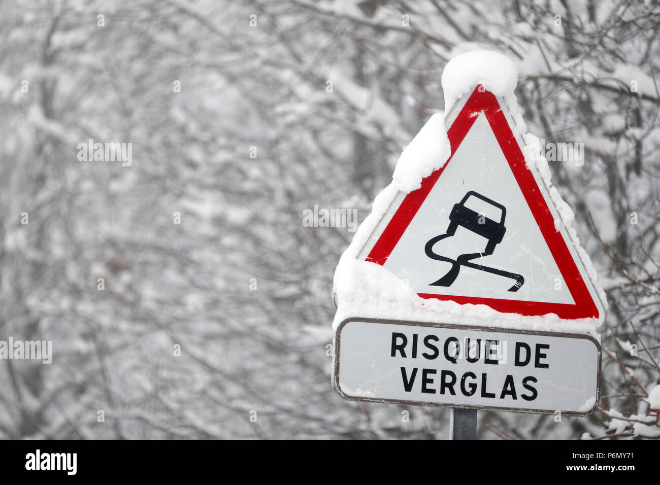 Mountain road in winter.  Road signs. Saint-Gervais. France. - Stock Image