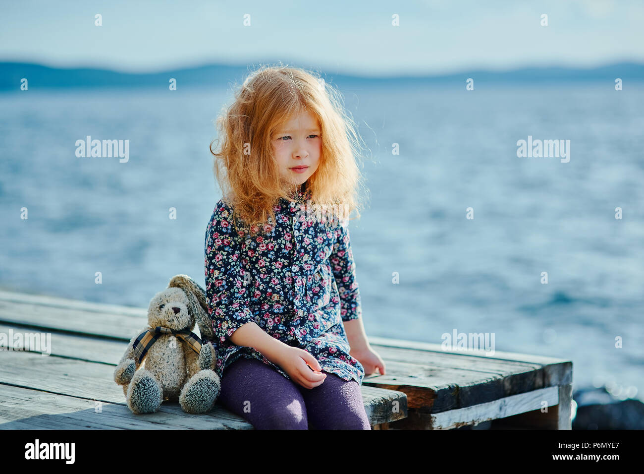 Sad Looking Girl Sitting On The Beach Stock Photos Sad Looking