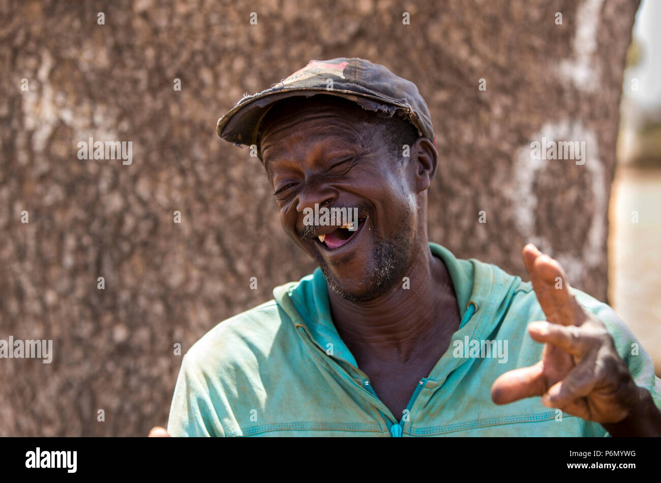 Smiling Togolese with missing teeth. - Stock Image