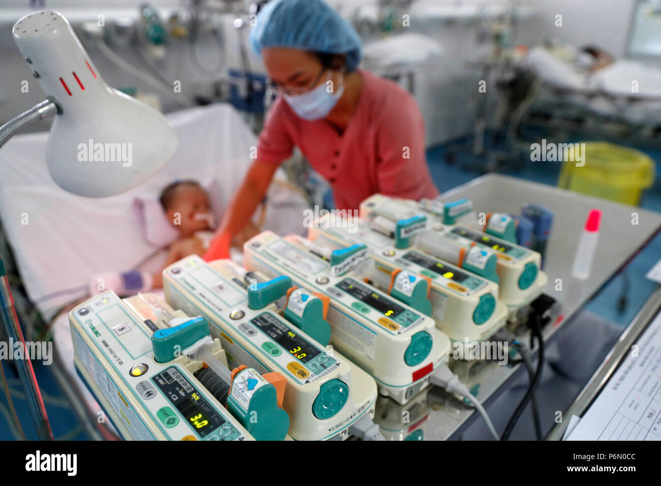 Tam Duc Cardiology Hospital. Vietnamese child suffering from heart diseases.  Intensive care unit. Ho Chi Minh City. Vietnam. - Stock Image