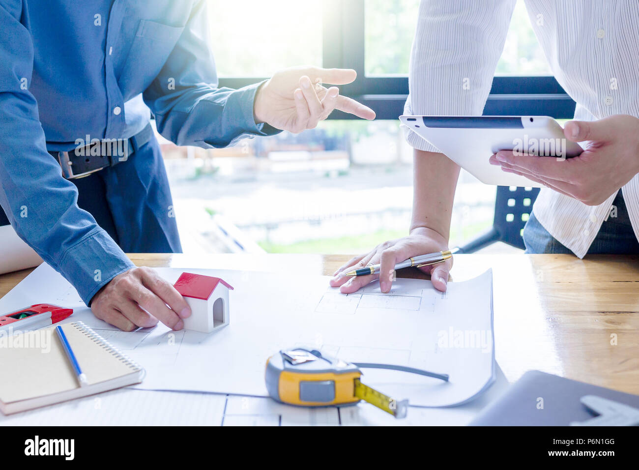 Team of engineers working together in a architect office