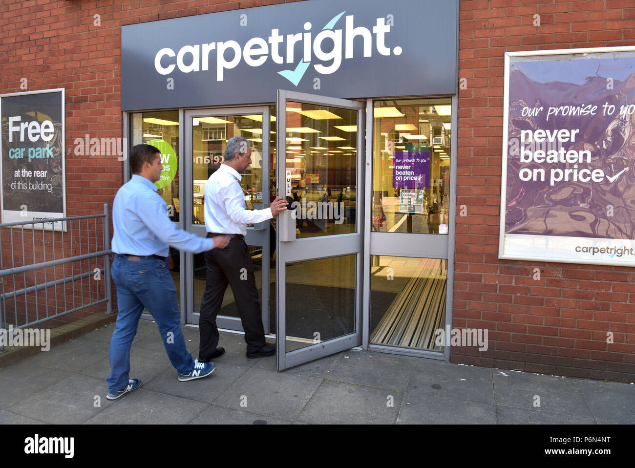 Customers enter the flooring and carpet specialist Carpetright on the Holloway Road, North London. Stock Photo