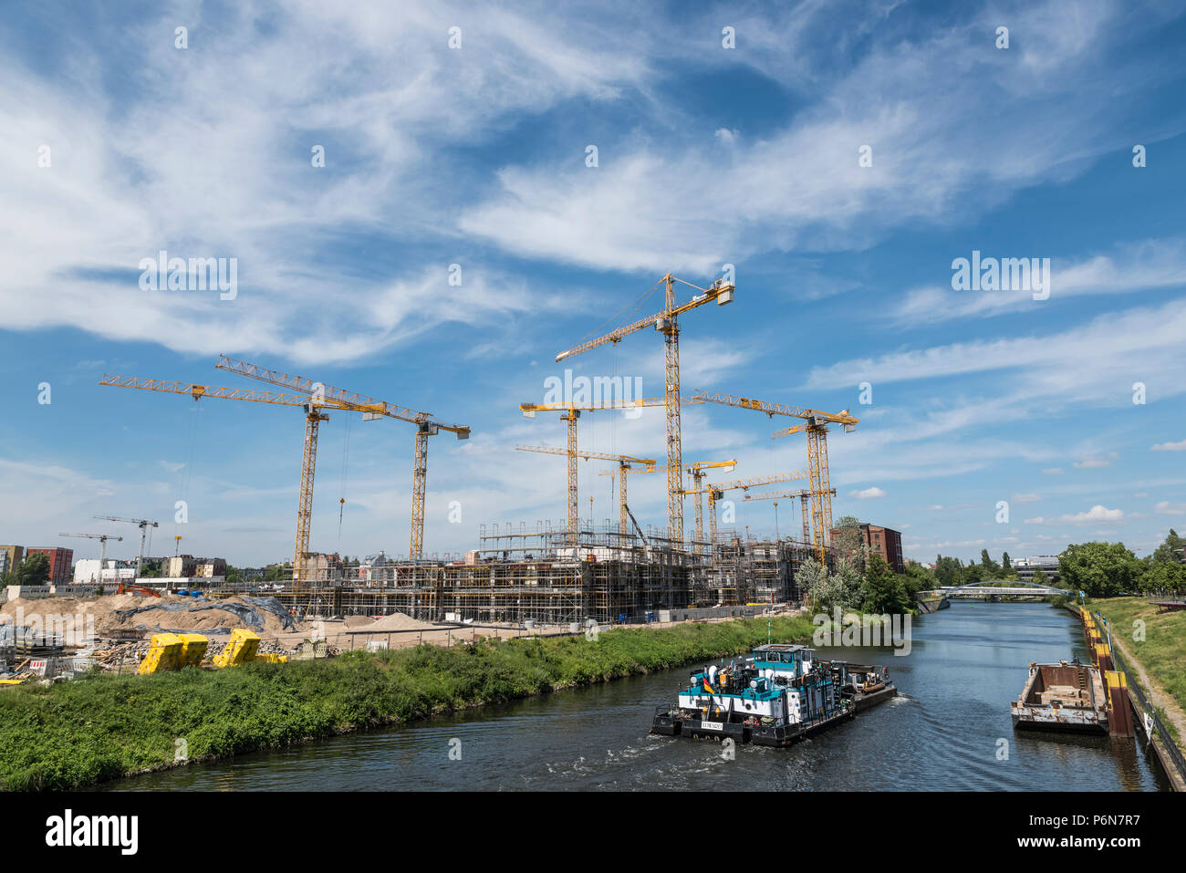 BERLIN, GERMANY, MAY 24, 2018: Many operating cranes at building site in Berlin, beside a canal. Stock Photo