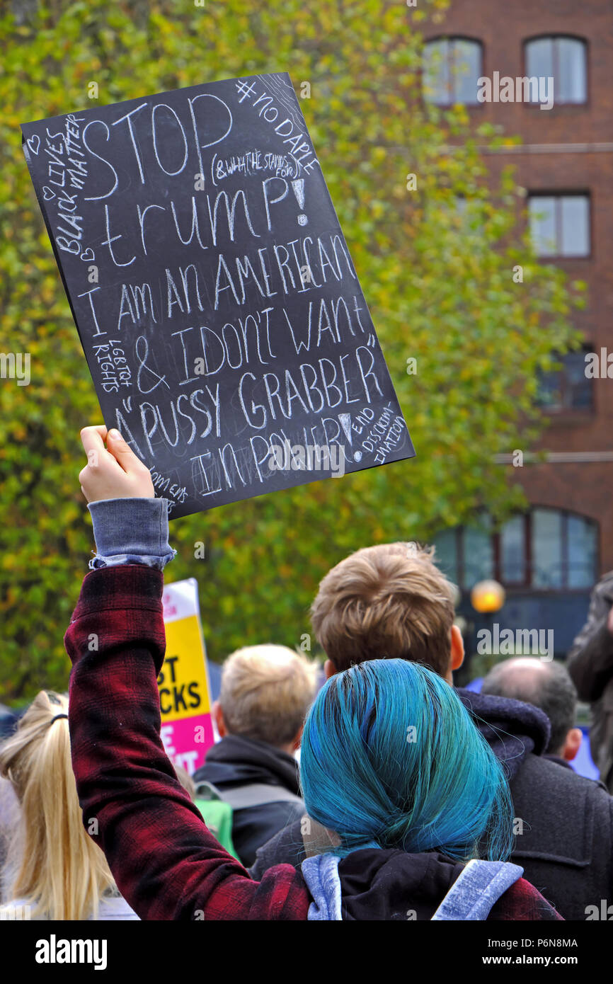 A woman holds a placard aloft at a demonstration against the election of Donald Trump as US president in Bristol, UK on 12 November 2016 Stock Photo