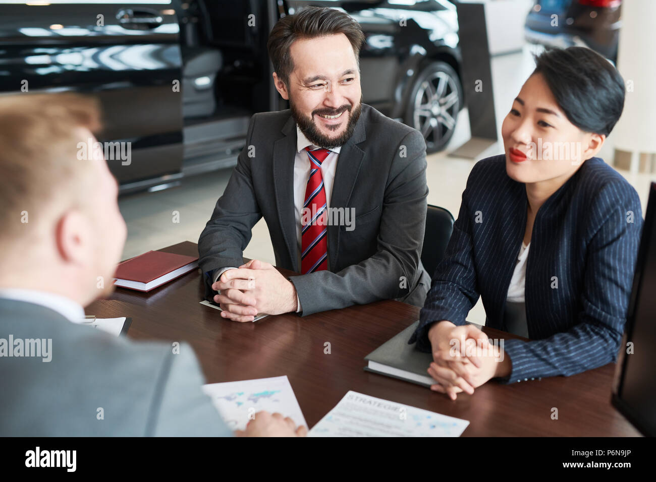 Business people at auto salon - Stock Image