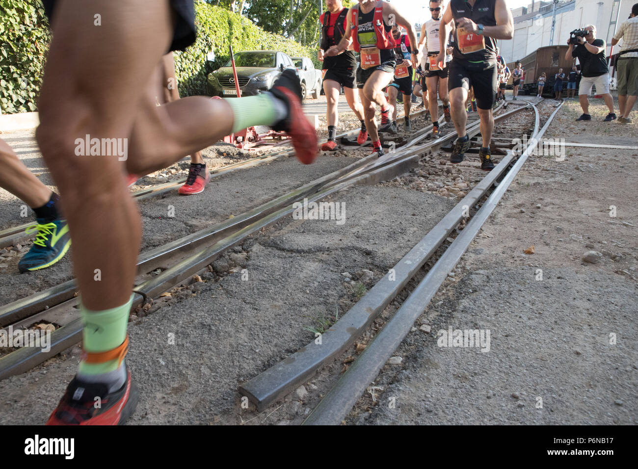 Group of runners male running in 'The iron way' from Palma de Mallorca to Soller, train railway race, Balearic islands Spain - Stock Image