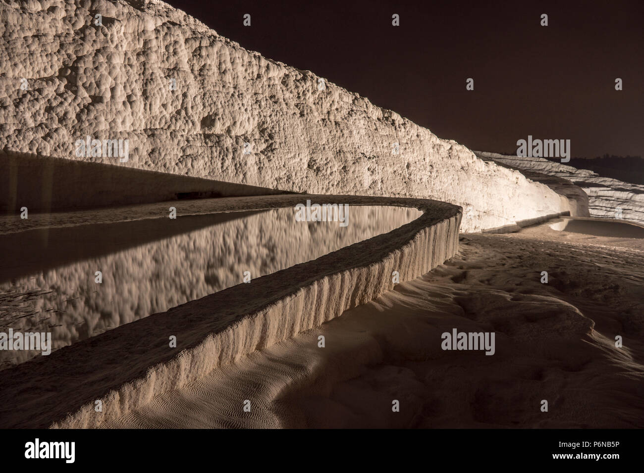 Nightscape shot of Natural travertine pools and terraces in Pamukkale. Cotton castle in southwestern Turkey, - Stock Image