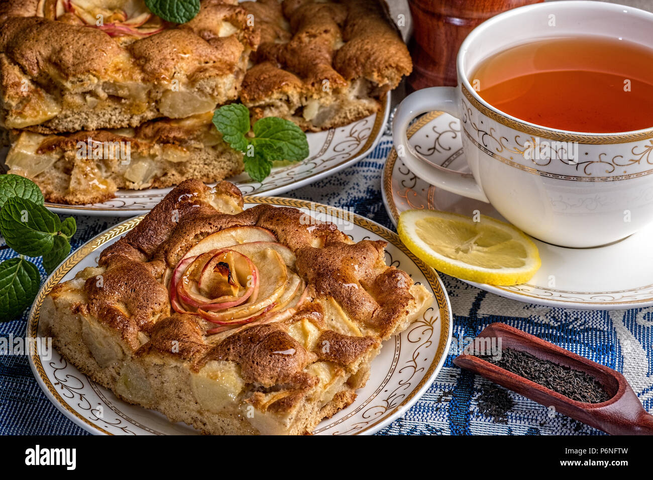 Delicious Warm Apple Pie On Plate With Cap Of Tea A Piece Of Cake