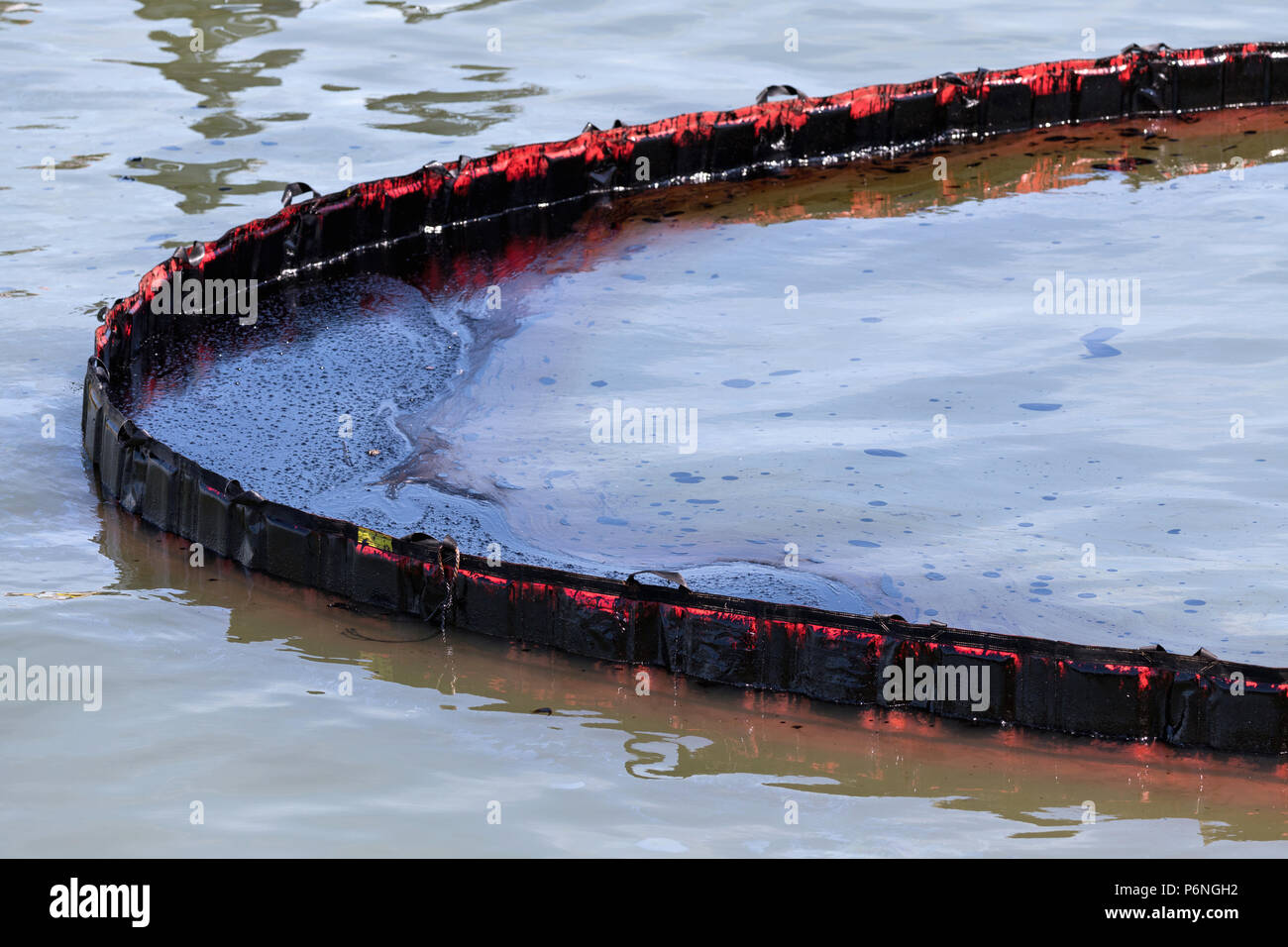floating barrier to dam oil pollution - Stock Image
