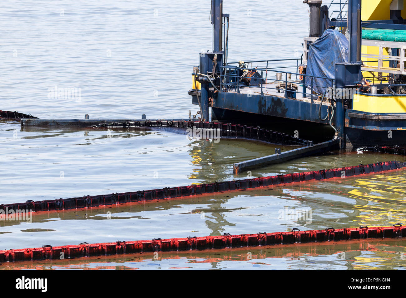 oil-spill response vessel cleaning pollution in the water - Stock Image