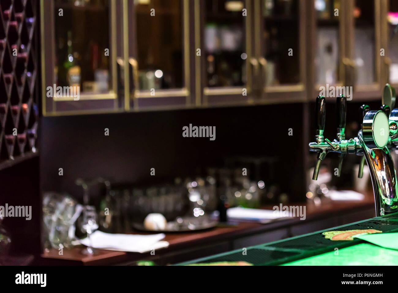 Chrome Beer Taps In Modern Bar