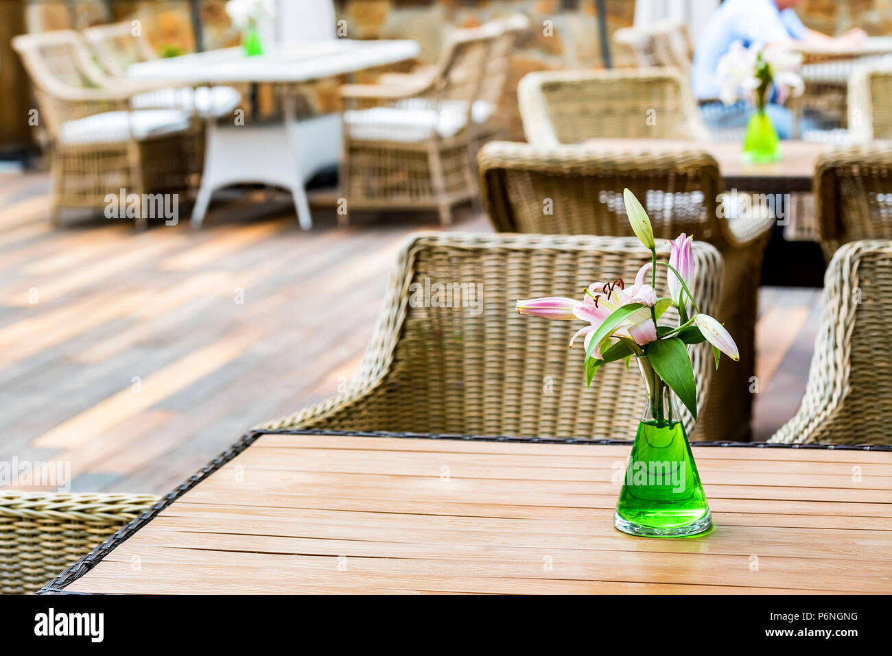 Outdoor restaurant interior with wicker chairs Stock Photo