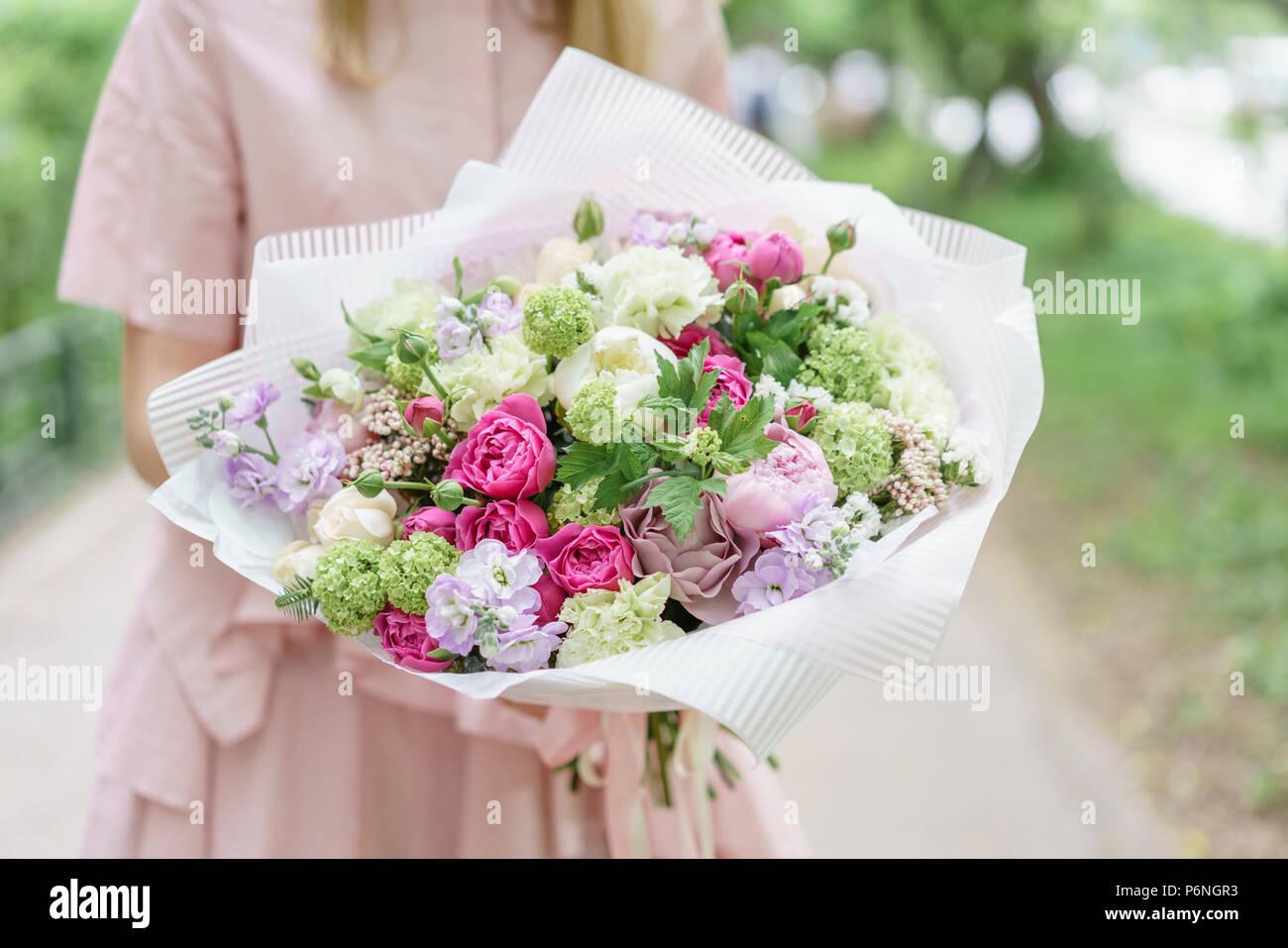 Young Girl Holding A Beautiful Summer Bouquet Flower Arrangement