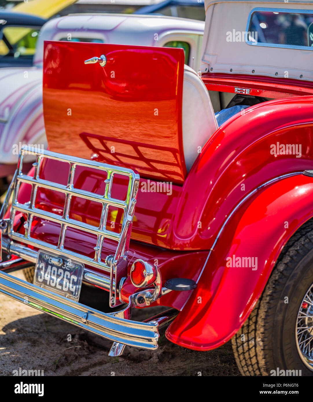 Rumble seat and luggage rack on a customized vintage automobile. - Stock Image