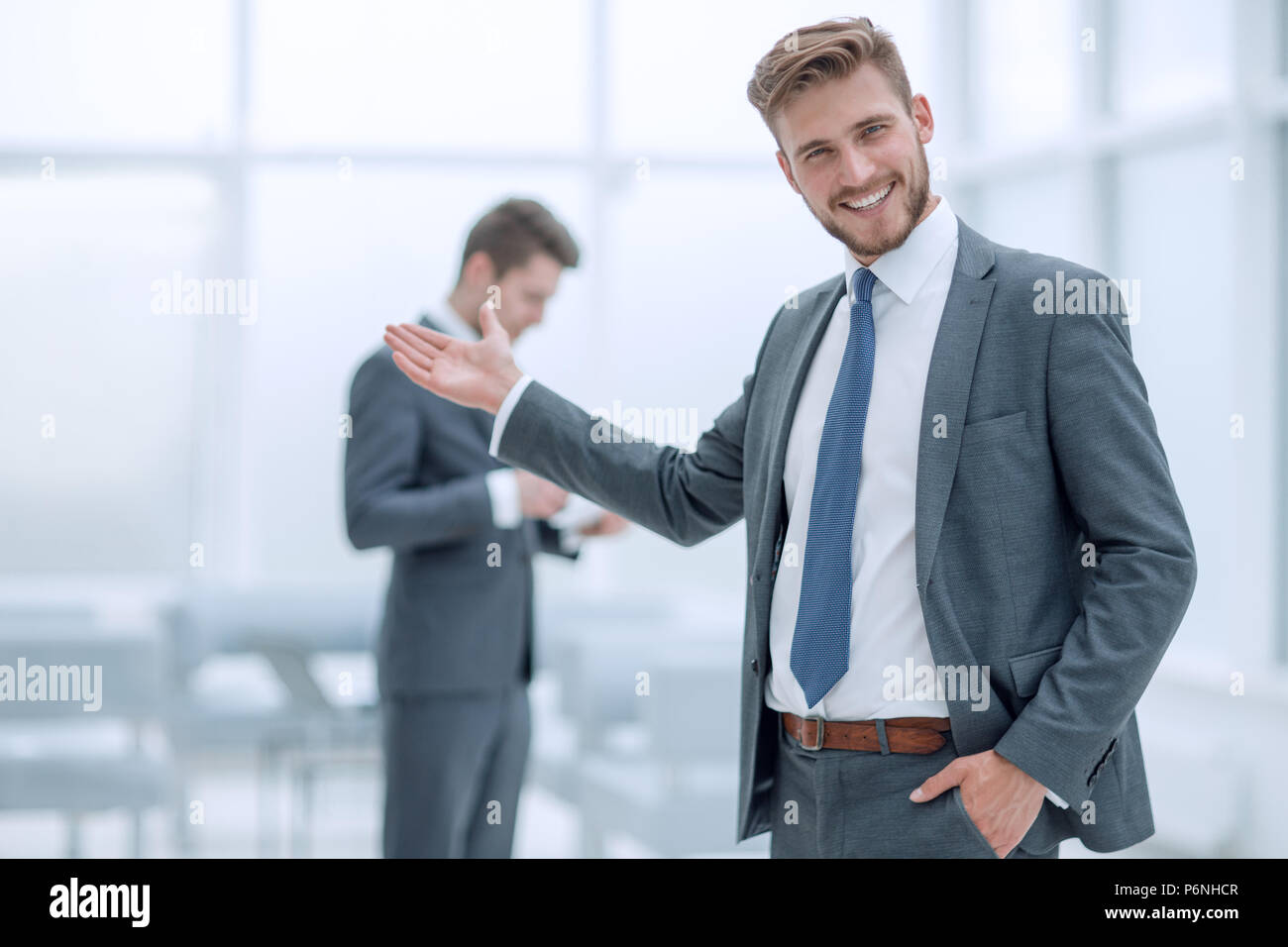 Successful Businessman Invites You To The Office Stock Photo Alamy