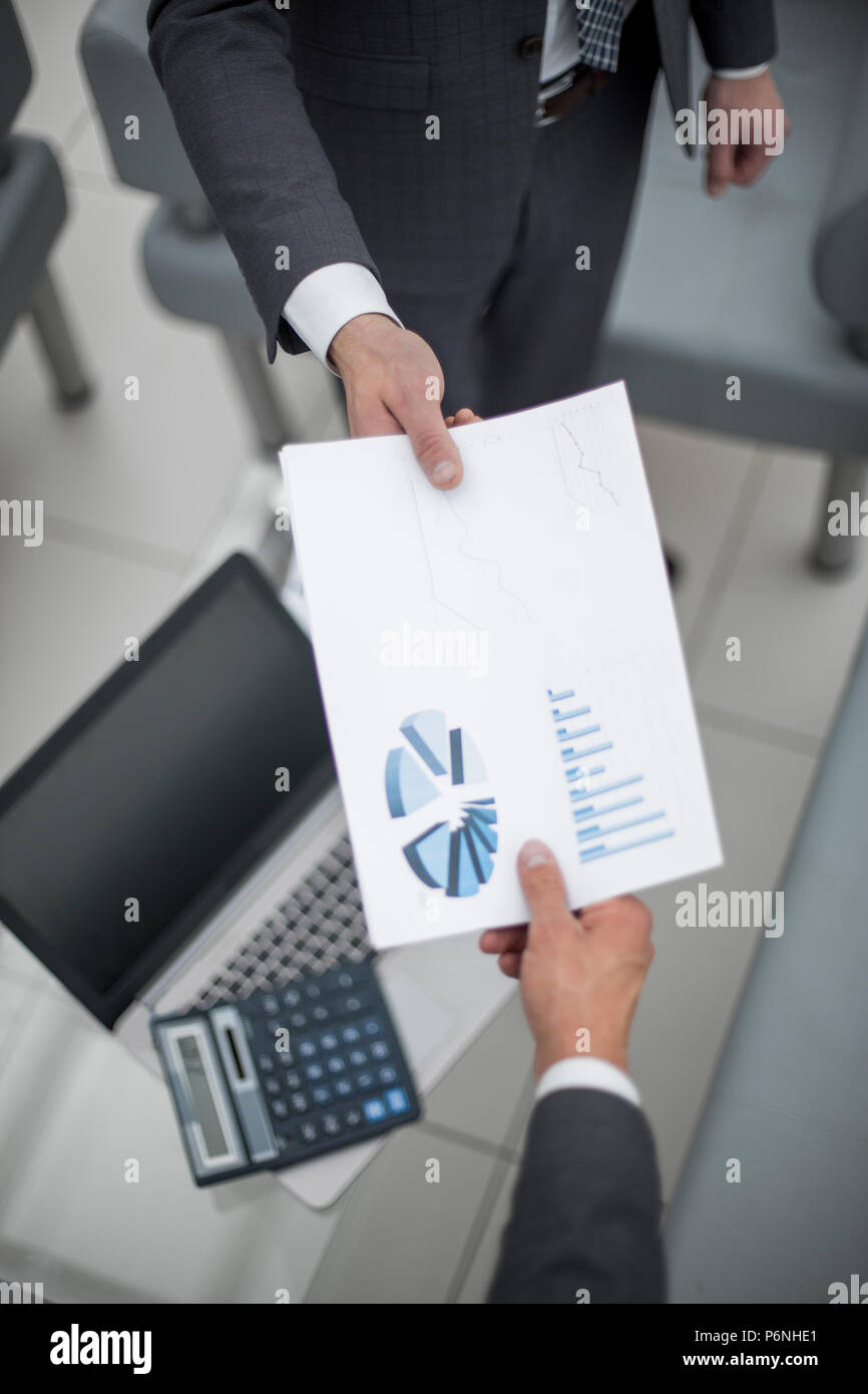 Loan officer sends credit bureau reports to bank manager. - Stock Image