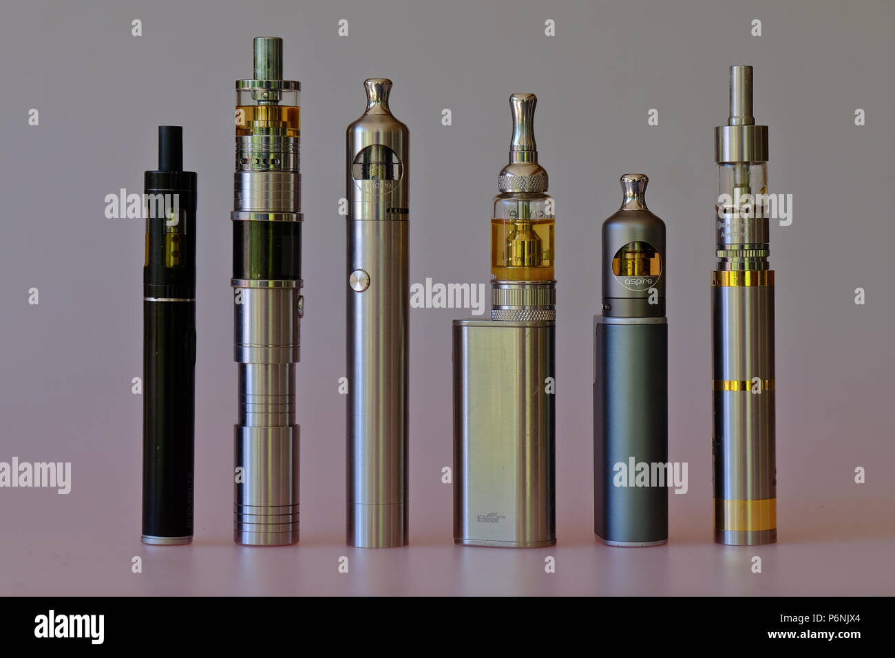A set of different tube ecigarette devices for eletronic smoking or vaping with eliquid - Stock Image