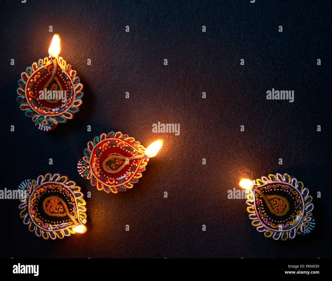 Happy Diwali - Colorful Diya lamp on floor - Stock Image