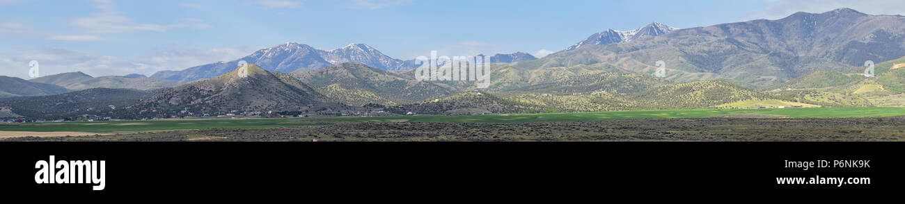 Panorama of Oquirrh Mountain range which includes The Bingham Canyon Mine or Kennecott Copper Mine, rumored the largest open pit copper mine in the wo Stock Photo
