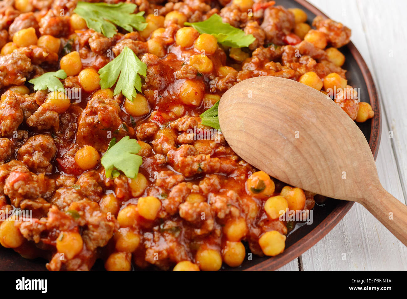 Traditional Cuisine Mexican Chili With Chickpeas Bi And Wooden Spoon On A Wooden Table Stock Photo Alamy