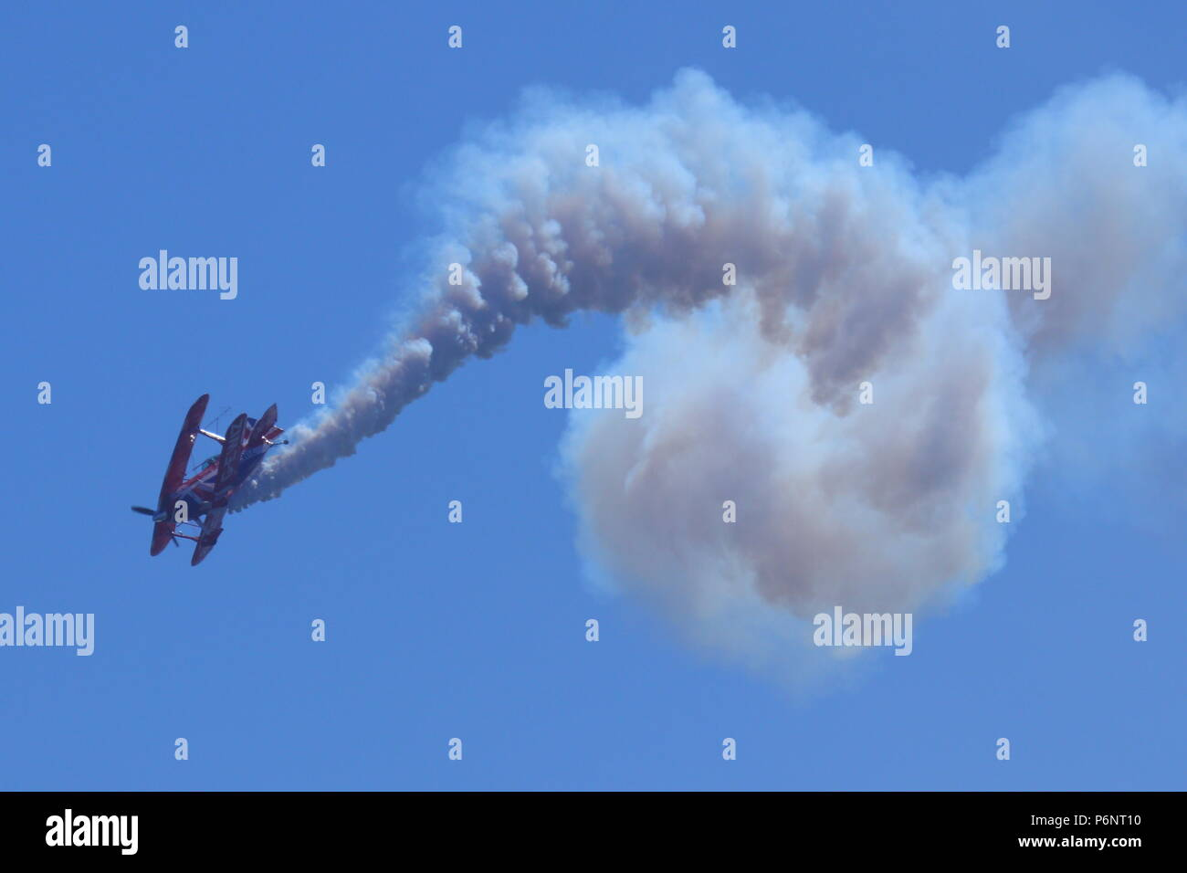 Rich Goodwin's Bi-plane performing acrobatic displays at Scarborough Armed Forces Day. - Stock Image
