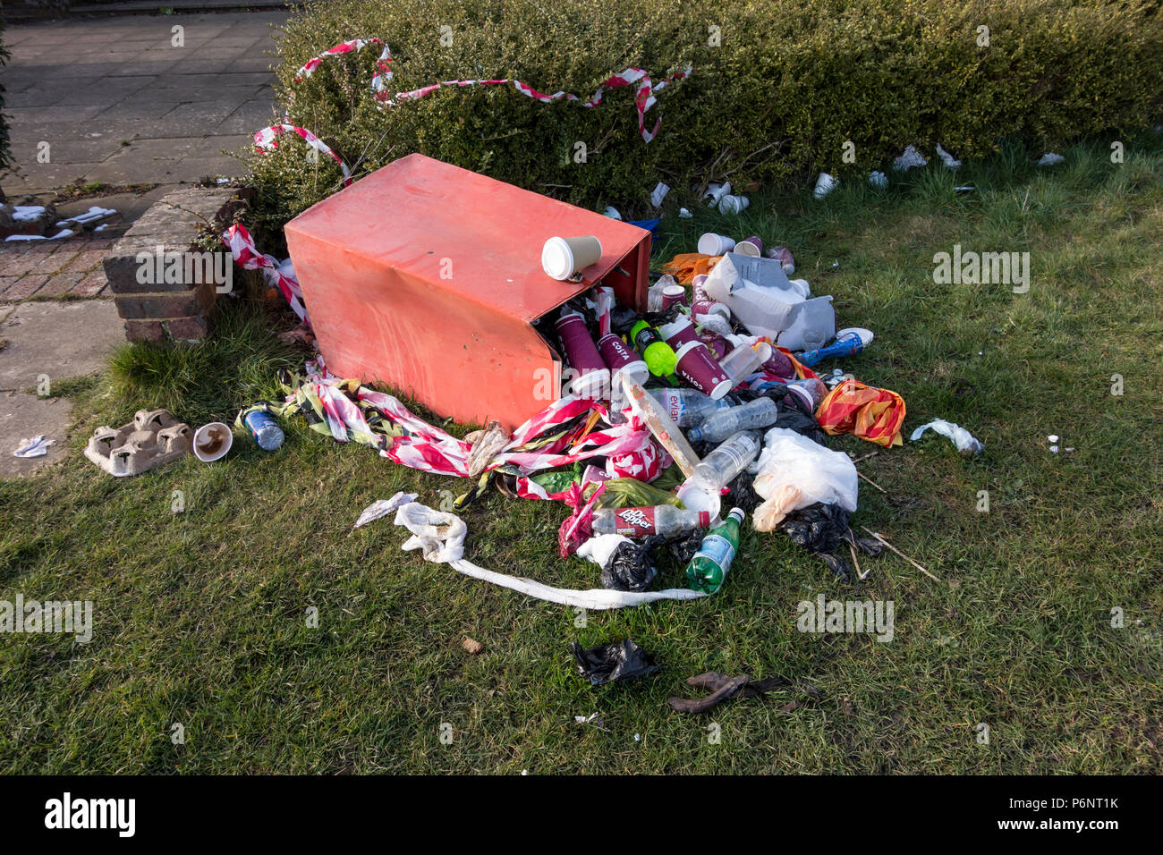 Overflowing garbage bin, UK - Stock Image