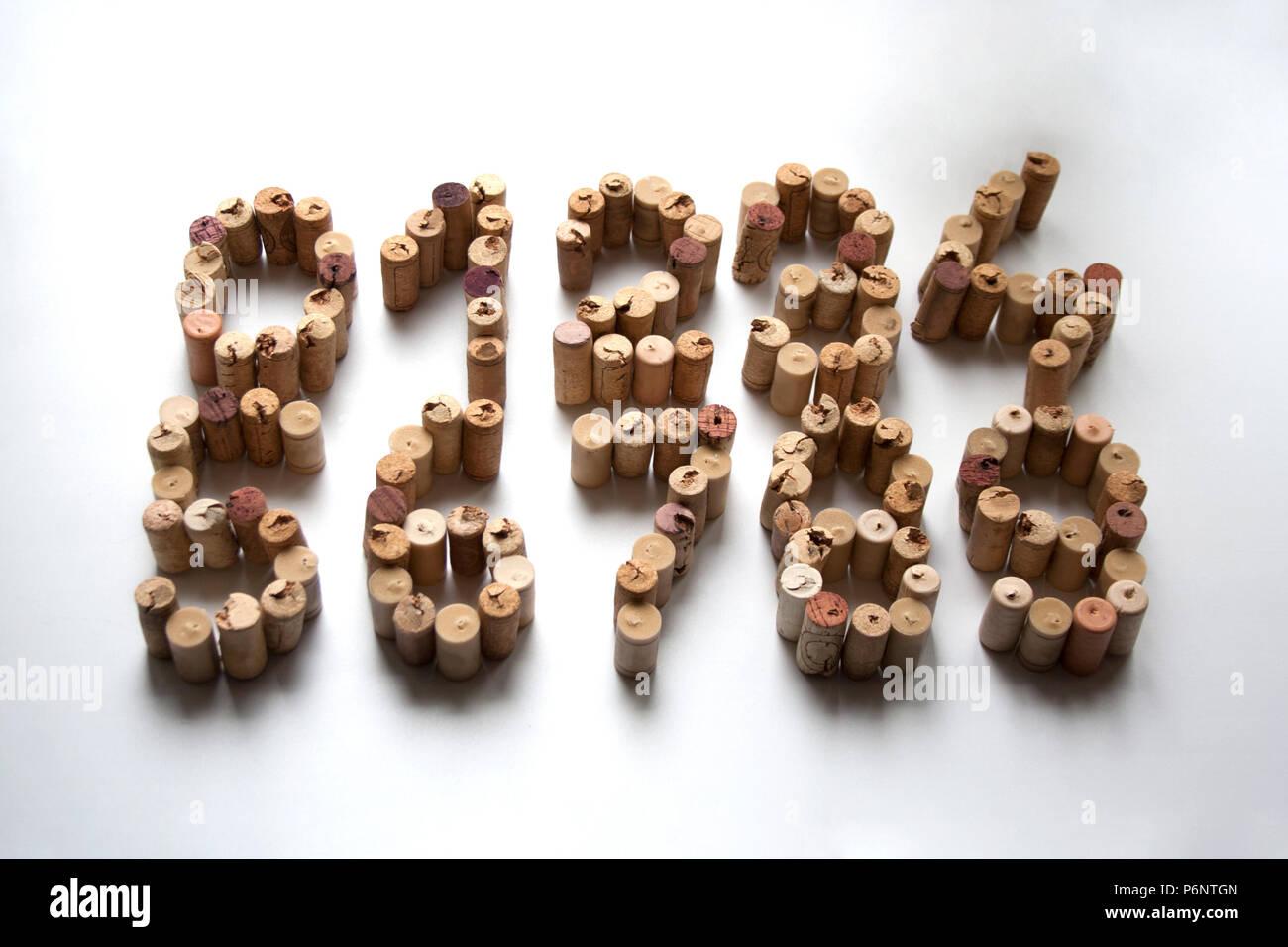 Wine cork digits isolated on white background - Stock Image