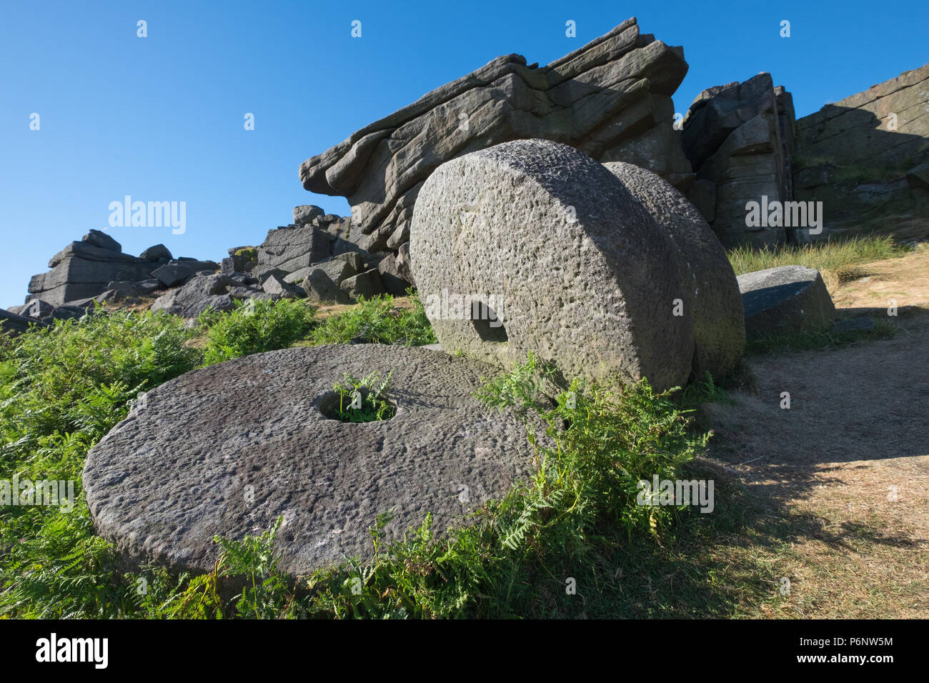 Peak District millstones at Stanage Edge, Derbyshire. - Stock Image