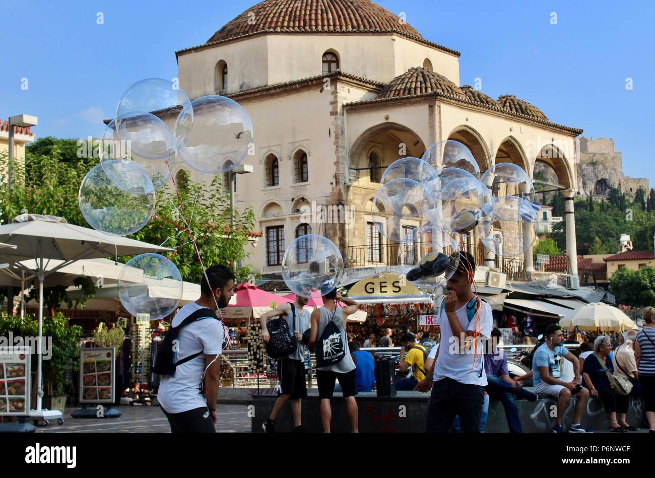 two men selling bubble shaped balloons athens greece - Stock Image