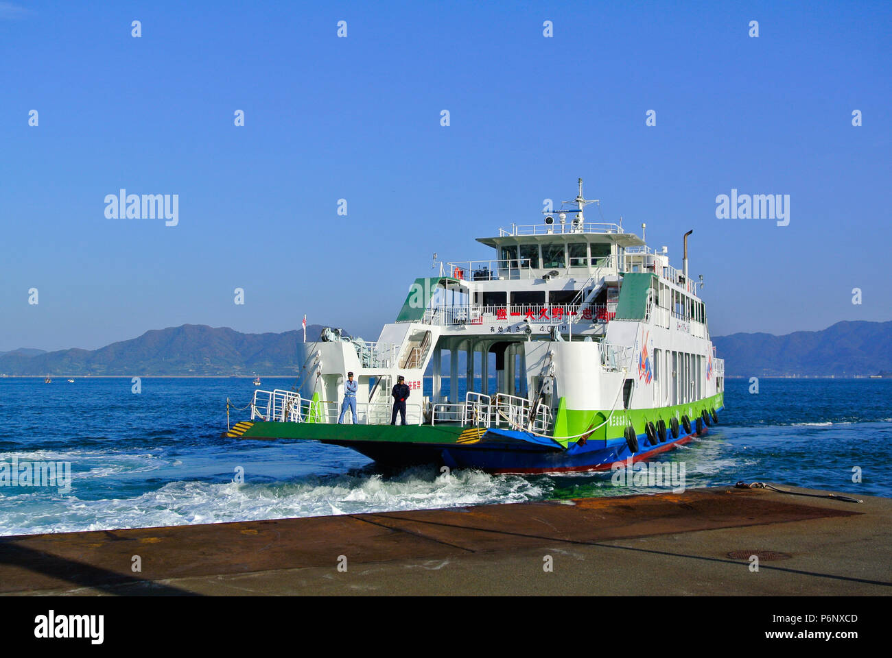 Ferry boat embarking at Setonaikai National Park, Hiroshima, Japan Stock Photo