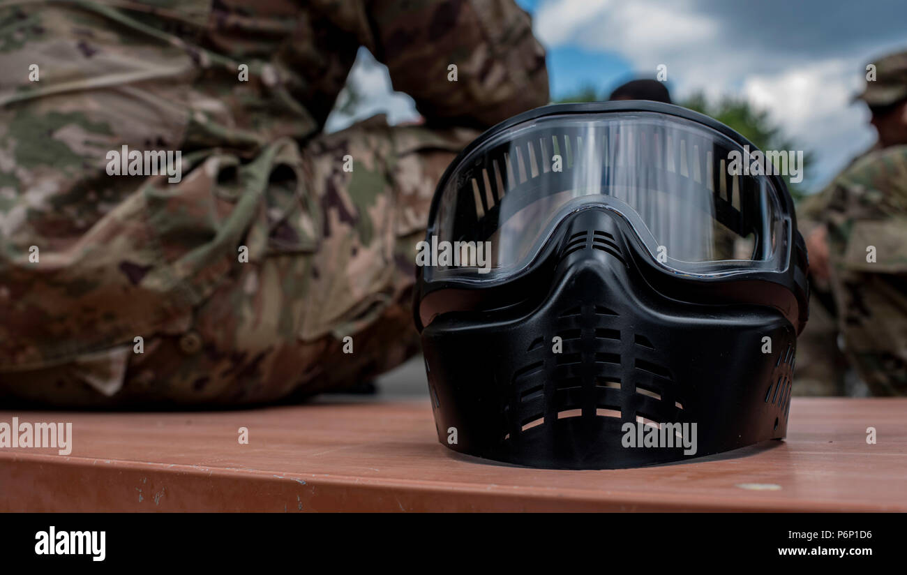 A paintball mask sits on a picnic table during a Delta Detachment, 1st Space Company, Joint Tactic Army Ground Station exercise at Misawa Air Base, Japan, June 22, 2018. With the JTAGS detachment eight hours away from the nearest U.S. Army base, it is important to build, bond and network with sister services. The remote location gives soldiers an opportunity to see how sister branches operate. The tasks in the exercise are important to the Army and Soldiers in Misawa because no matter where they are, the same tasks are taught. After a long day of learning battle drills, reports and Self-Aid Bu - Stock Image