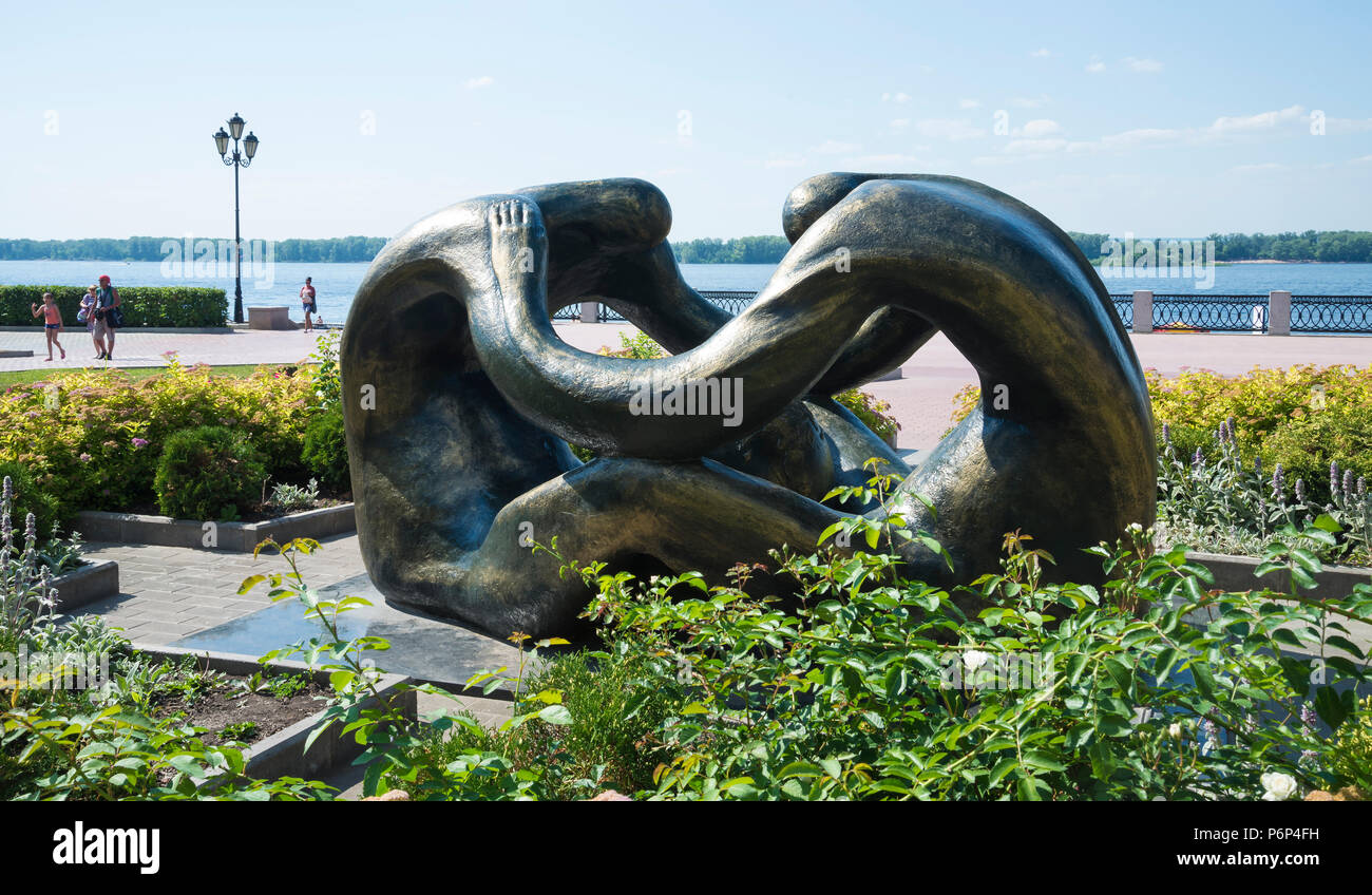 The sculpture is the Cradle of humanity located on the Volga river embankment in Samara, Russia. On a Sunny summer day. - Stock Image