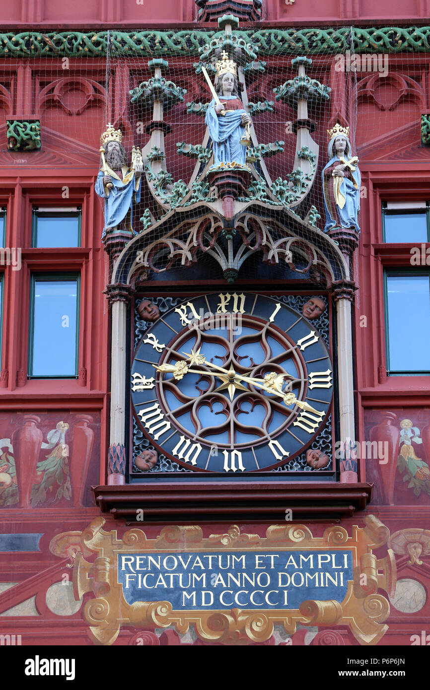 The red medieval Basel Town Hall (Rathaus). Clock on the wall.  Basel. Switzerland. - Stock Image