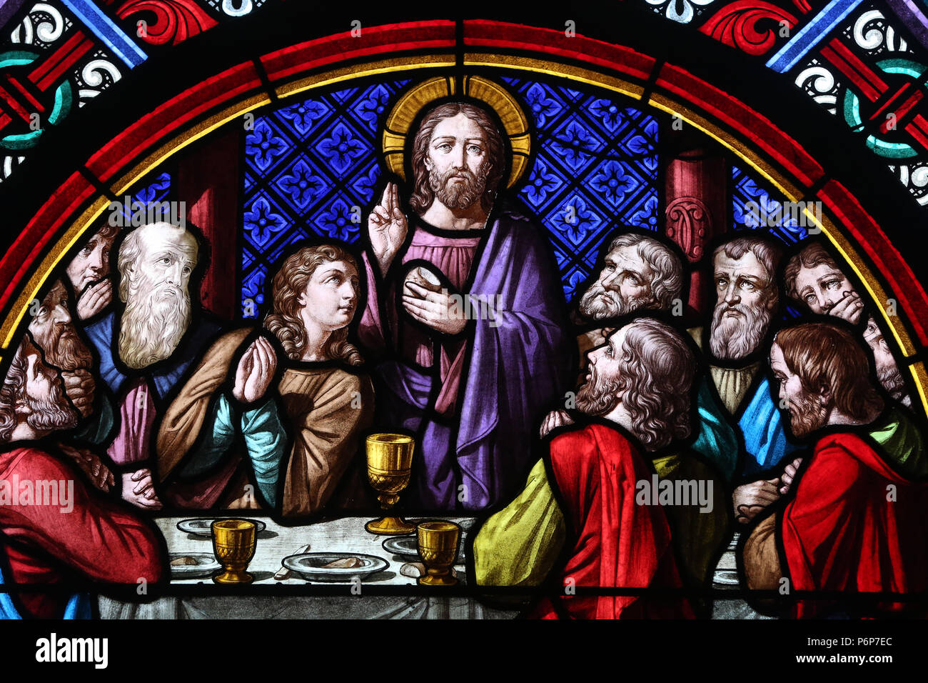 Basel Cathedral Minster. Stained glass window.  The Last Supper is the final meal that Jesus shared with his Apostles.  Switzerland. - Stock Image