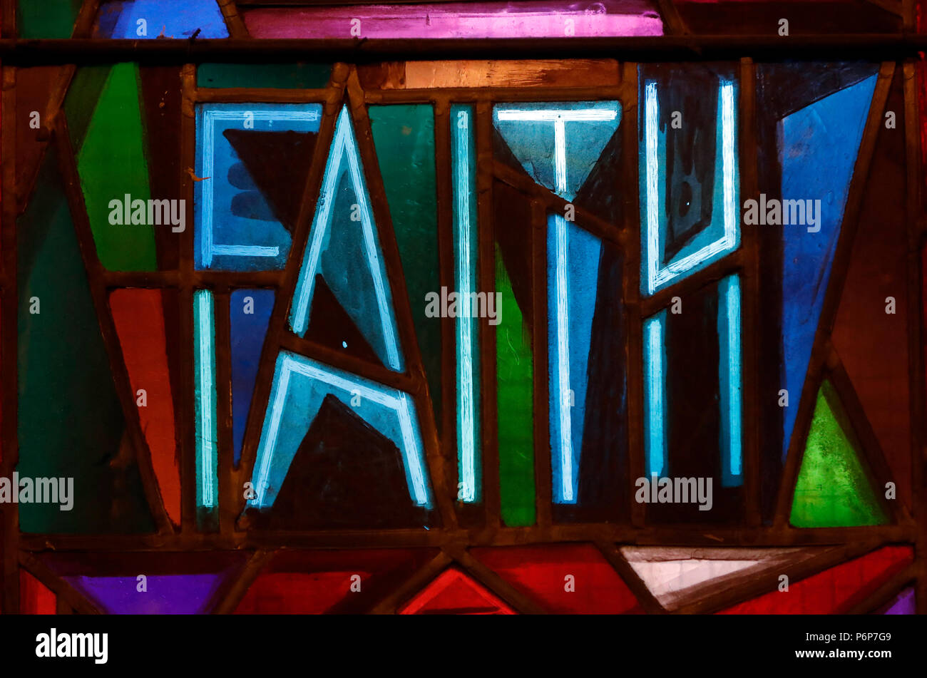 The church of the Holy Trinity.   Stained glass window.  Charity.  Geneva. Switzerland. - Stock Image