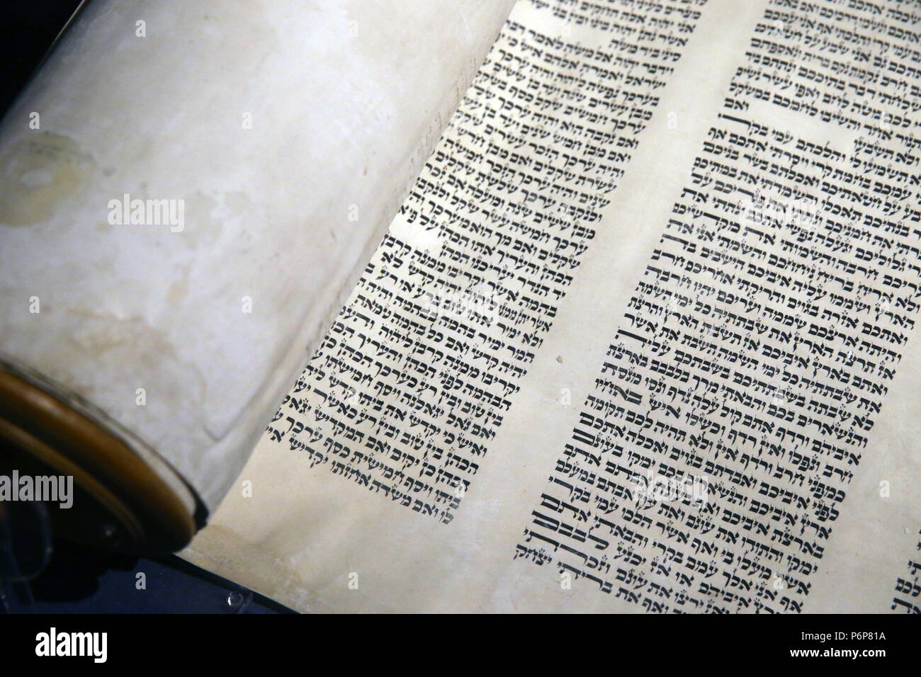 Jewish Museum of Switzerland. Basel.  Old Torah scroll with Hebrew writing. Close-up. - Stock Image