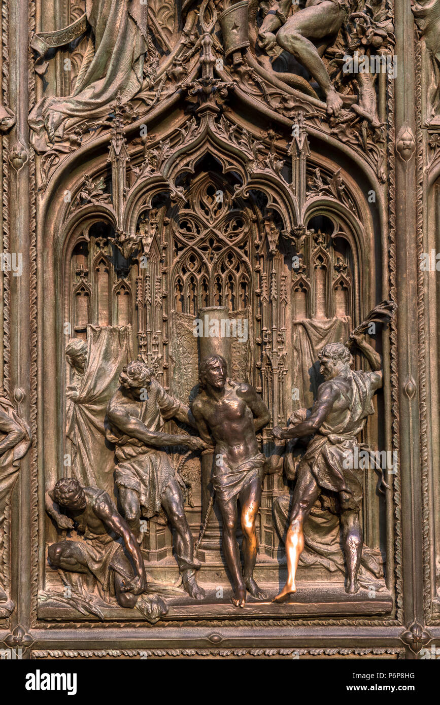 Detail of a relief on a door of the Duomo, Jesus whipped, Milan, Italy. - Stock Image