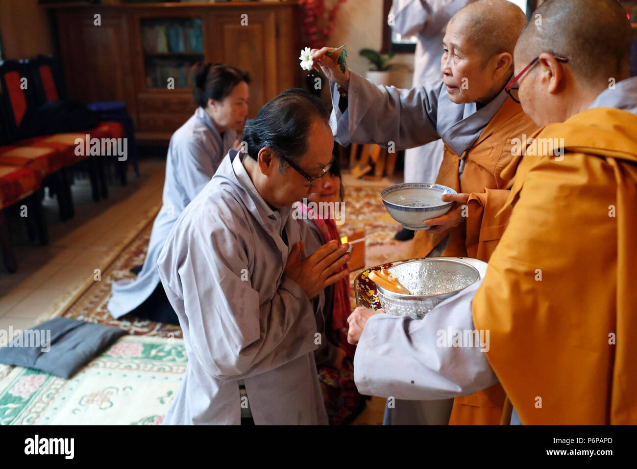 Chua Tu An Buddhist temple. Buddhist worship. Monk ordination ceremony. Saint-Pierre en Faucigny. France. - Stock Image