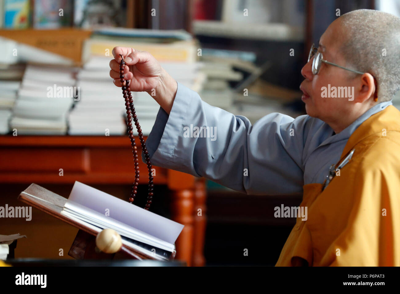 Chua Tu An Buddhist temple.  Monk at buddhist ceremony.  Buddhist prayer beads or mala.  Saint-Pierre en Faucigny. France. - Stock Image