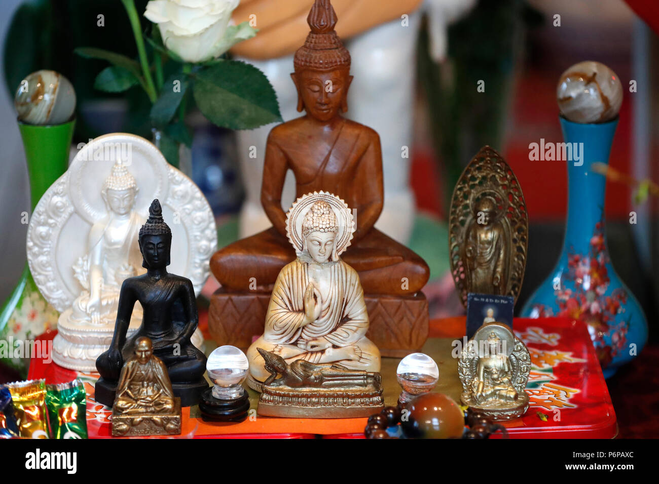 Chua Tu An Buddhist temple. Buddha statues on altar.  Saint-Pierre en Faucigny. France. - Stock Image