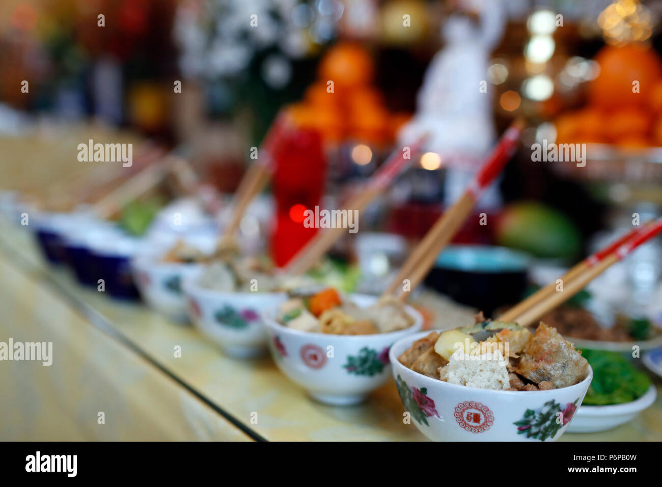 Chua Tu An Buddhist temple.  Ancestor altar. Vegetarian offerings. Saint-Pierre en Faucigny. France. - Stock Image