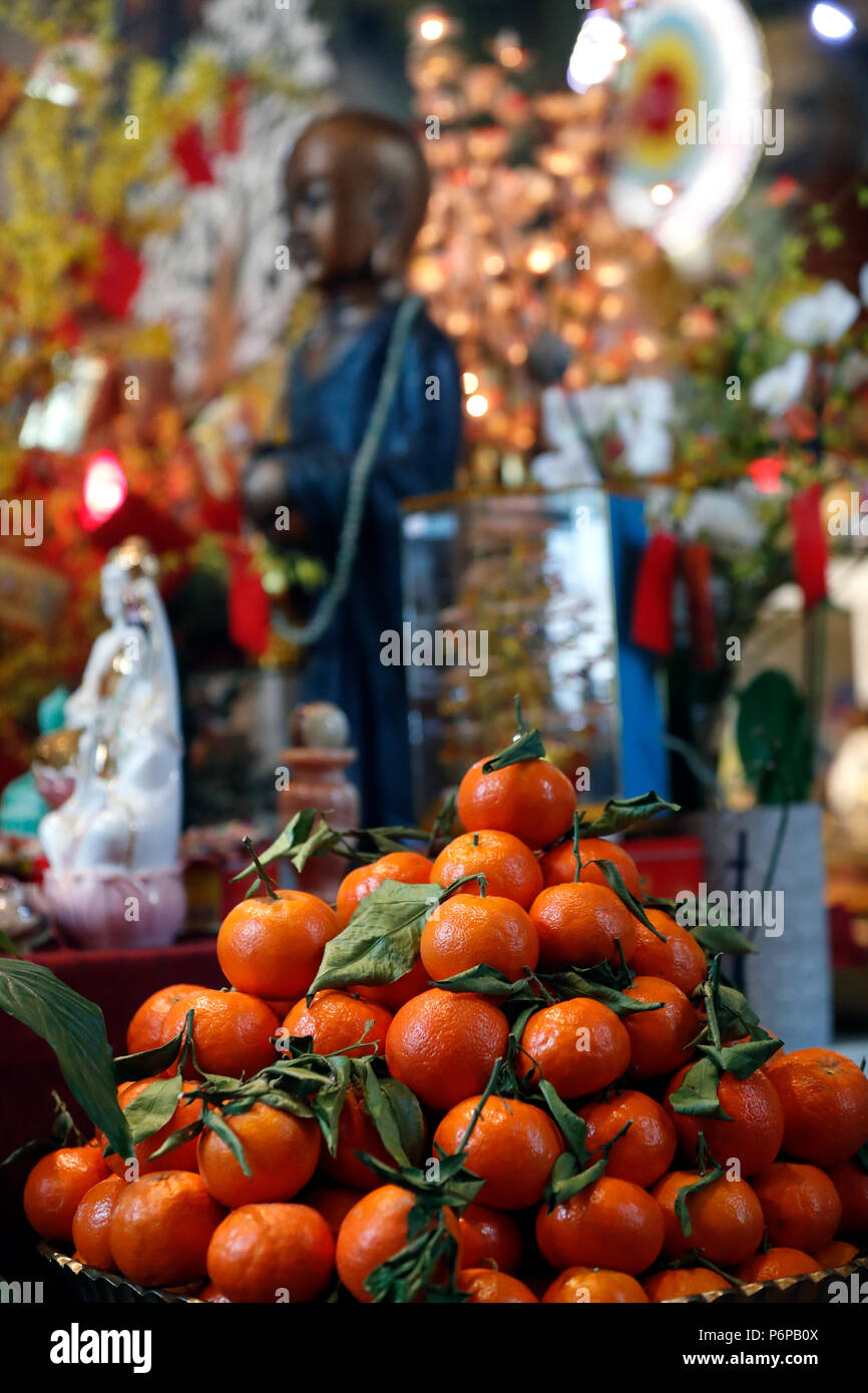 Chua Tu An Buddhist temple. Chinese new year. Offerings : mandarins.  Saint-Pierre en Faucigny. France. - Stock Image