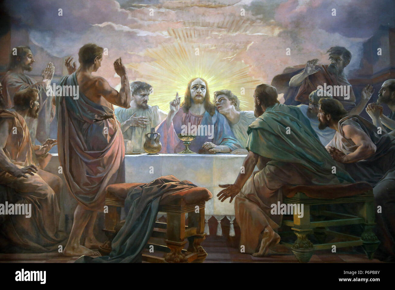Saint-Pierre de Neuilly catholic church. Neuilly, France. Detail of a fresco depicting the Last Supper and the Resurrection. - Stock Image