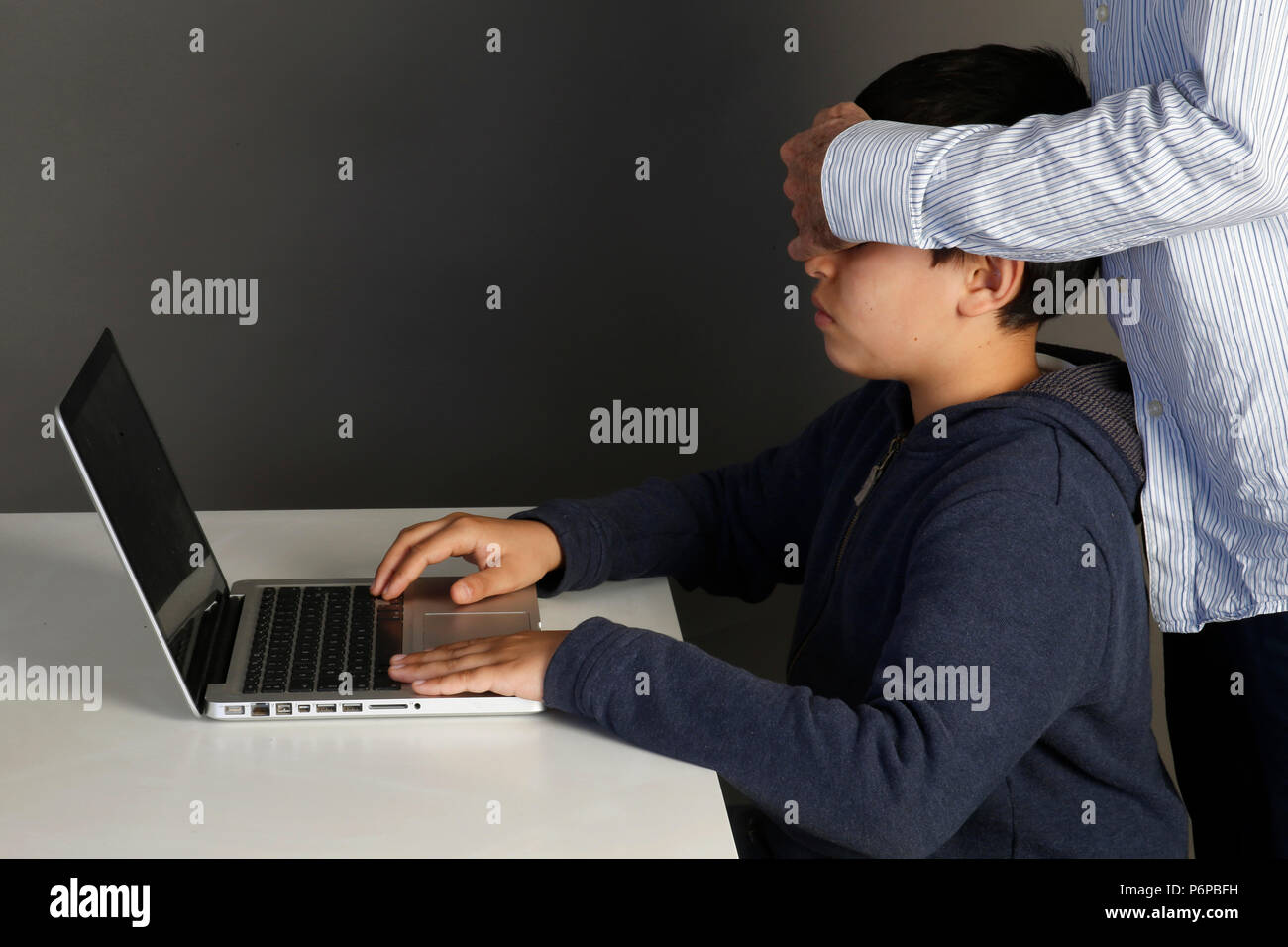 12-year-old boy forbidden to look at an internet site. Paris, France. - Stock Image