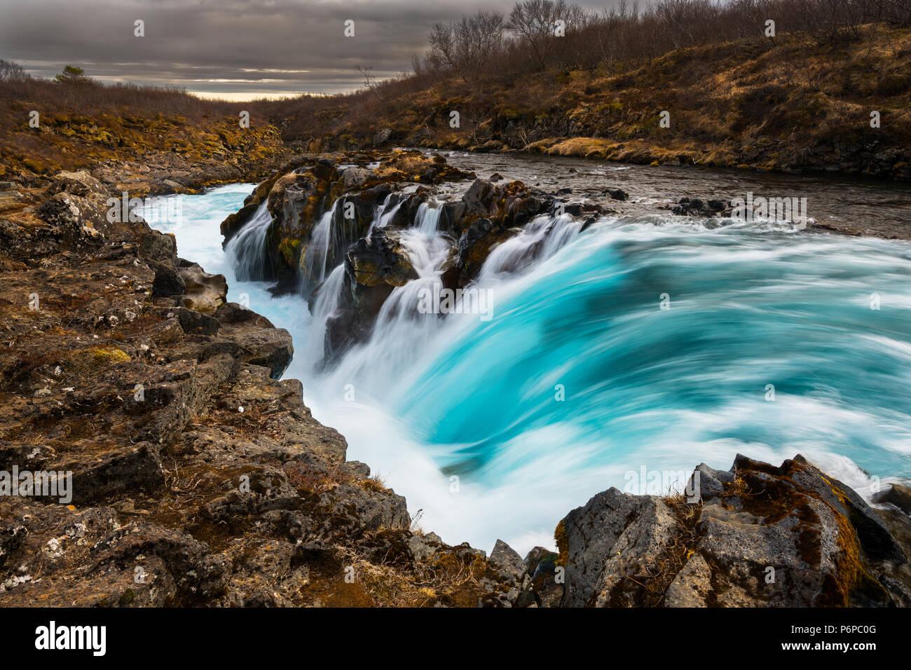 Beautiful blue Hlauptungufoss the river Brúará. - Stock Image