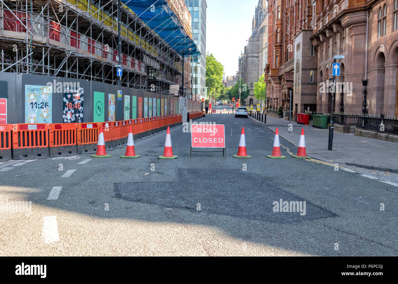 Cones and a Road Closed sign indicate a closed off road in Manchester city centre, UK. - Stock Image