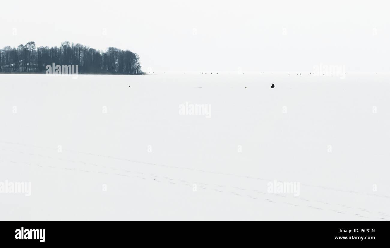 Winter fishing on iced lake, natural background  Minimalist