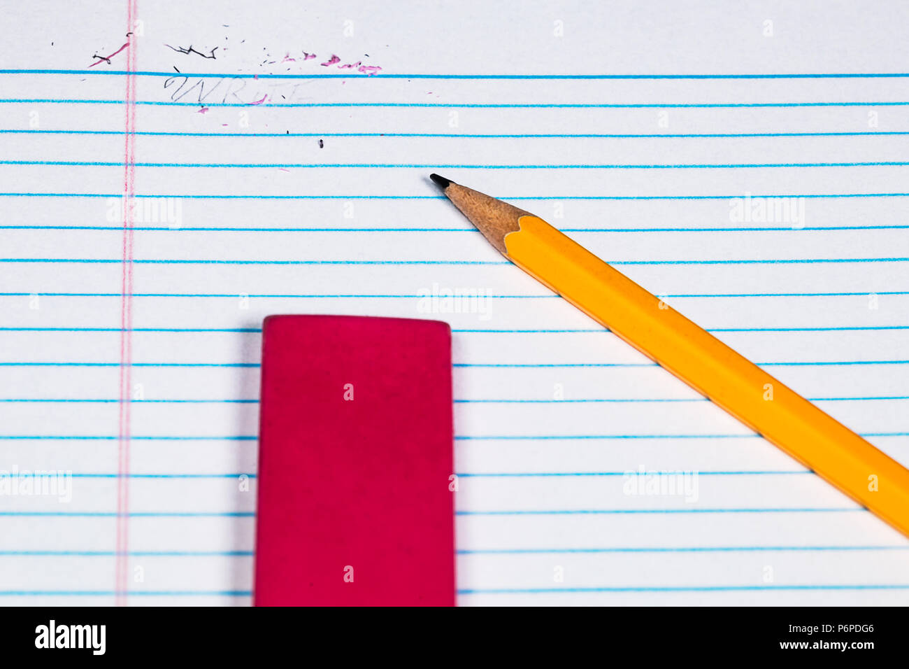a #2 Pencil, Eraser, paper clips and Filler paper with plenty of room for Copy.  An erased word and eraser dust still present - Stock Image