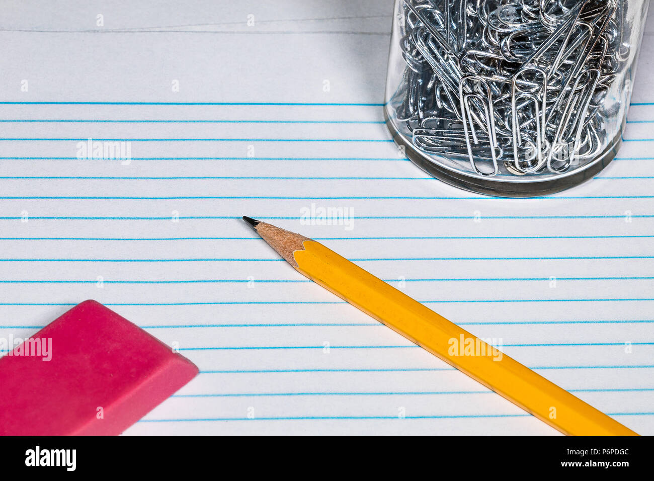 a #2 Pencil, Eraser, paper clips and Filler paper with plenty of room for Copy. - Stock Image