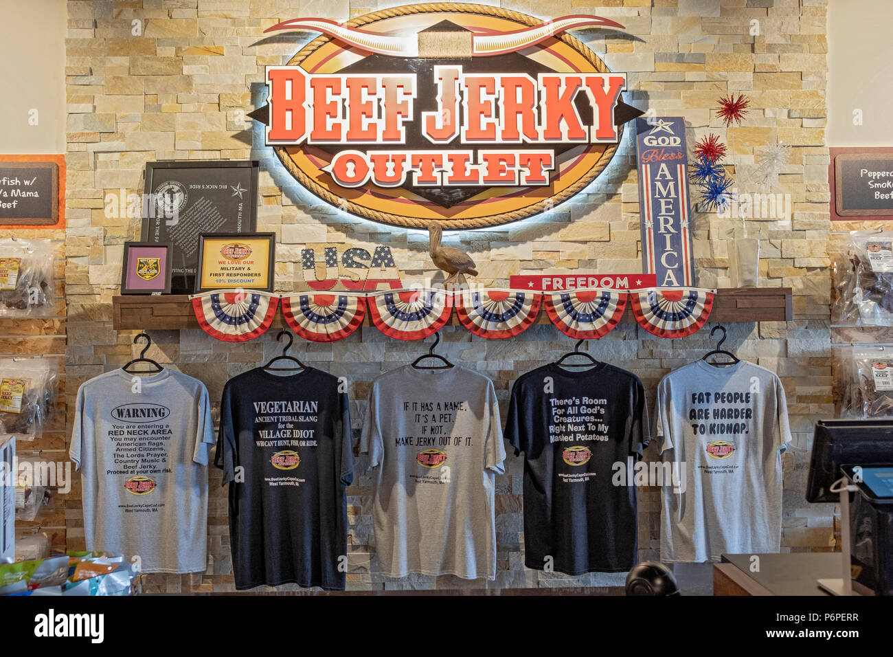 Tee shirts for sale at the BEEF JERKY OUTLET STORE in West Yarmouth, MA. - Stock Image